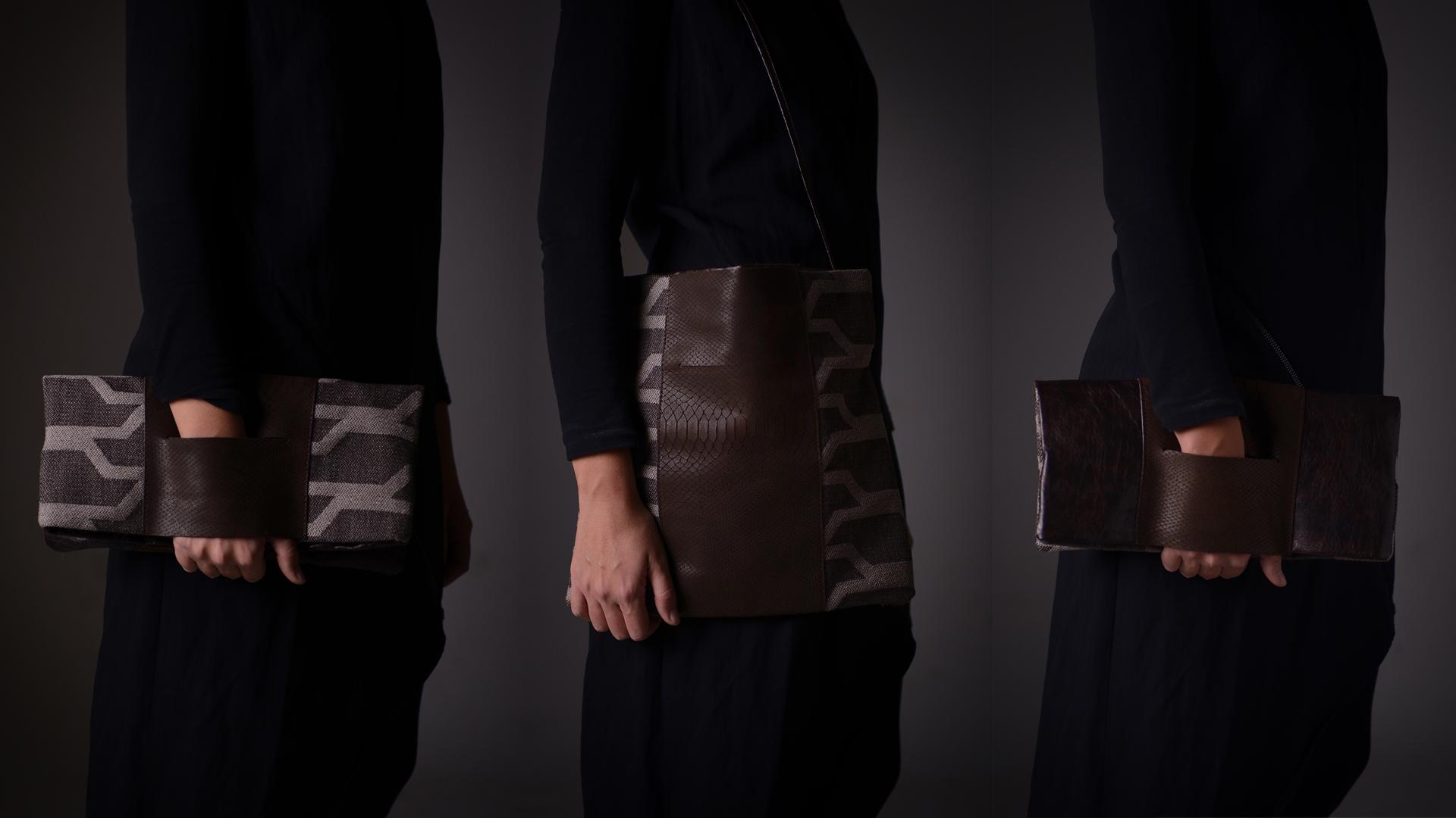 """Borsa """"Tagliomano"""", ovvero tre borse in una: si può indossare come pochette da un lato o dall'altro (uno realizzato con due tipi di pelle, l'altro in pelle e tessuto) oppure come una postina con la tracolla lunga"""