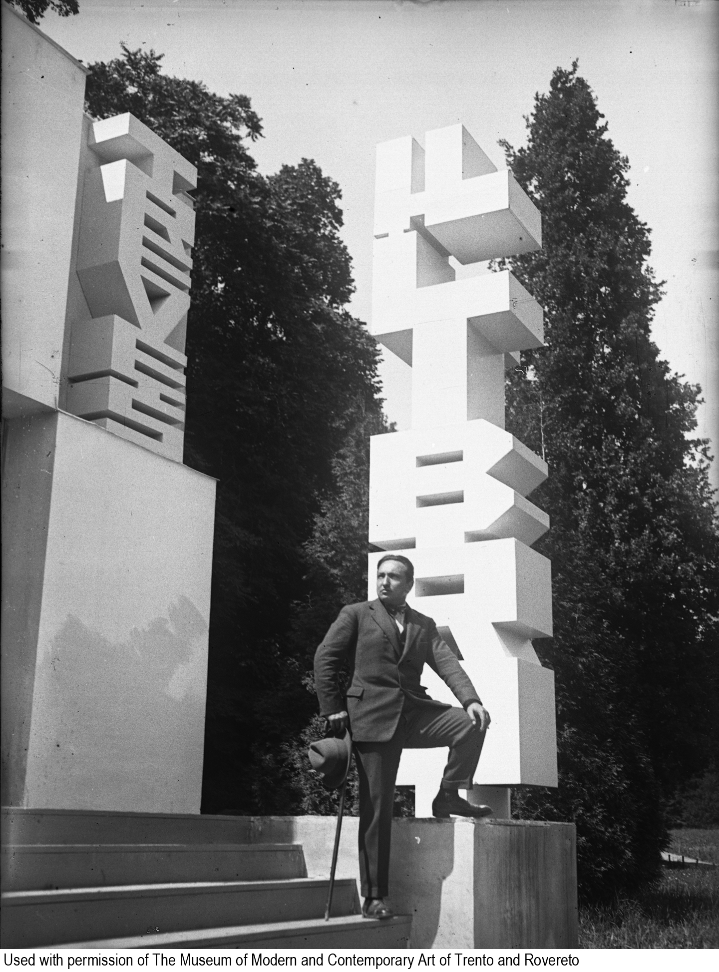 depero_posing_next_to_book_pavillion_with_credit