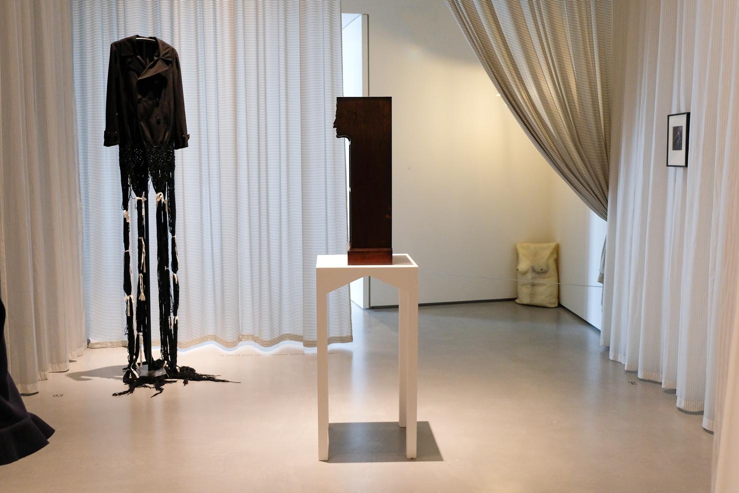 08 C F A  Voysey bookcase 1900 Robert Gober Untitled 1990 Yohji Yamamoto Long Hair coat 2003
